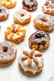 Group of colored glazed donuts — Stock Photo
