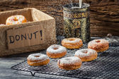 Falling icing sugar on fresh donuts — Foto de Stock