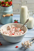 Whipped cream and fresh strawberries as ingredients for ice crea — Stock Photo