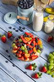 Closeup of preparing a healthy spring fruit salad — Stock Photo