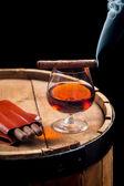 Taste of burnt cigar and cognac — Stock Photo