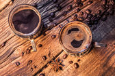 Closeup of hot coffee in old wooden table — Stock Photo