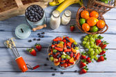 Preparing a healthy fruit salad — Stok fotoğraf