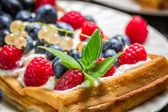 Closeup of waffels with cream and berry fruits — Stok fotoğraf