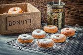 Closeup of falling powder sugar on fresh donuts — Stock Photo
