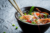Shrimp and vegetables served with noodles — Stock Photo