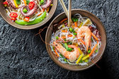 Chinese noodles with vegetables and seafood — Stock Photo
