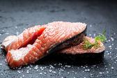 Fresh raw salmon with coarse salt — Stock Photo