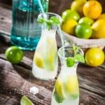 Closeup of fresh lemonade with fruit — Stock Photo #47760075