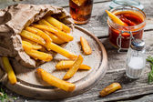 Closeup of homemade fresh fries with cold drink — Stock Photo
