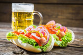 Fresh hot dog with sausage and vegetables — Stock Photo