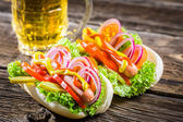 Two fresh homemade hot dog with beer — Stock Photo