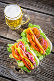 Hot dog with mustard, ketchup and vegetable — Stock Photo