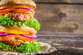 Closeup of homemade double-decker burger — Stock Photo
