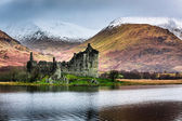 Old ruined castle on the background of snowy mountains — Stock Photo