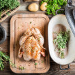 Preparation for roasting chicken with herbs — Stock Photo #48386813
