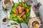 Richly set table for Thanksgiving with turkey and soup — Stock fotografie