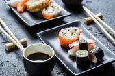 Closeup of sushi on a black ceramic — Stock Photo