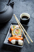 Fresh sushi served in with tea — Stock Photo