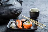 Closeup of fresh sushi served in a black ceramic — Stock Photo