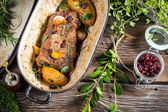Venison roasted with rosemary, garlic and cranberries — Stock Photo