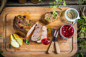 Venison and baked potato served with cranberry sauce — Stock Photo