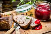 Closeup of venison with cranberry sauce — Stock Photo