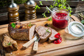 Healthy venison with cranberries and rosemary — Stock Photo