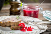 Venison with cranberry sauce on white plate — Stock Photo