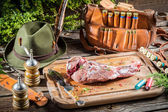 Preparing venison by a hunter — Stock Photo