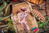 Fresh red venison meat with rosemary and pepper — Stock Photo