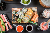Sushi surrounded by fresh ingredients — Stock Photo