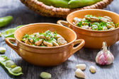 Broad beans served with parsley and garlic — Stock Photo