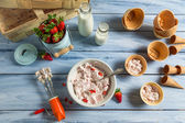 Fresh cream and strawberries as ingredients for ice cream — Stock Photo