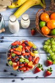 Preparing a healthy spring fruit salad — Stock Photo