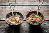 Two dishes with vegetables and seafood — Stock Photo