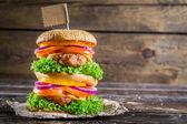 Enjoy your tasty double-decker hamburger — Stock Photo