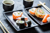 Sushi served with soy sauce for two — Stock Photo