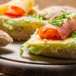 Fresh sandwich made of chive, ham lettuce and cheese — Stock Photo #49230009