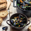 Fresh ingredients for a dish cooked with mussels — Stock Photo #49230791