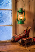 Warm cottage in a winter evening — Stock Photo