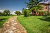 Stone road to the country house — Stock Photo