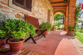 Beautiful porch in front of an home in Tuscany — Stock Photo