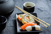Closeup of fresh sushi served in with tea — Stock Photo