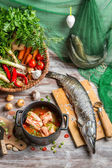 Pike and fresh vegetables for fish soup — Stock Photo