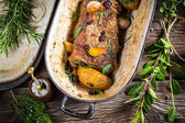 Vegetables roasted with venison and rosemary — Stock Photo