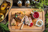 Freshly served venison with cranberries and rosemary — Stock Photo