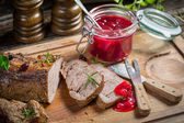 Venison served with cranberry sauce — Stock Photo