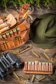Belt with hunter bullets and binocular — Stock Photo