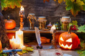 Witch table with halloween pumpkin — Stock Photo
